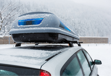 Roof rack attached to the roof of a snowy car